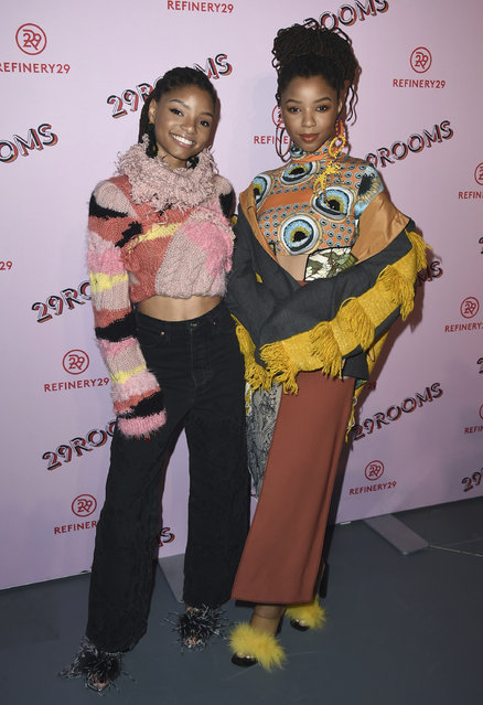 Halle Bailey, left, and Chloe Bailey, of Chloe x Halle, arrives at the West Coast debut of 29rooms at ROW DTLA on Wednesday, December 6, 2017, in Los Angeles. (Photo by Jordan Strauss/Invision/AP Photo)