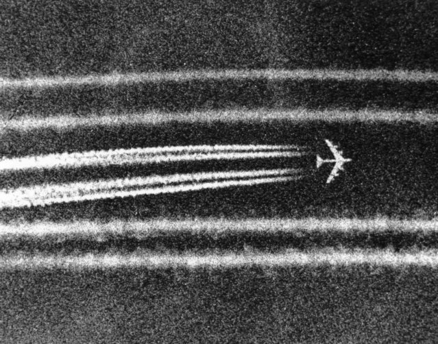"B52 high altitude bombers leave miles-long condensation trails while passing the town of Cai Lay in the Mekong Delta on September 29, 1972, moments after unleashing tons of bombs on suspected enemy positions. The giant jet aircraft are virtually invisible at altitude save for the ""contrails"". (Photo by Nick Ut/AP Photo)"