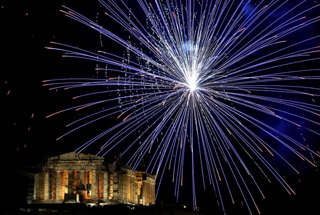 Fireworks explode over the Parthenon during celebrations in Athens. (Photo by Petros Giannakouris/Associated Press)