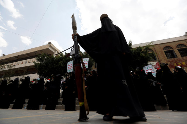 A woman loyal to the Houthi movement holds an RPG weapn as she takes part in a parade to show support for the movement in Sanaa, Yemen September 6, 2016. (Photo by Khaled Abdullah/Reuters)