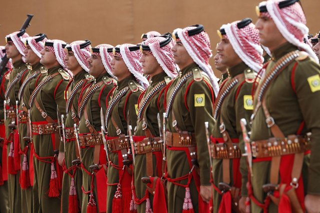 Jordanian Bedouin guards of honour stand as Jordan's King Abdullah reviews them before the opening of the 17th Parliament's second ordinary session in Amman November 2, 2014. (Photo by Muhammad Hamed/Reuters)