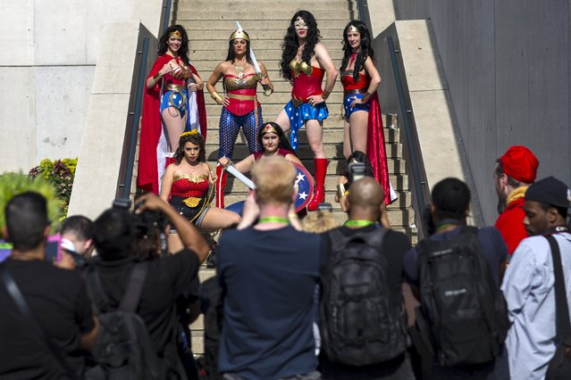 A group of people dressed as Wonder Woman pose for photographers on day two of New York Comic Con in Manhattan, New York, October 9, 2015. (Photo by Andrew Kelly/Reuters)