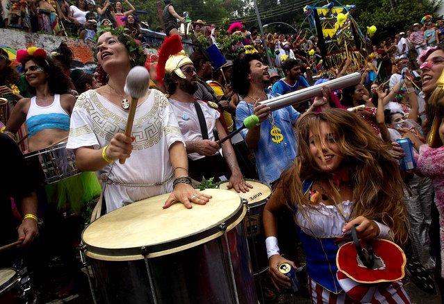 "A band performs during the ""Ceu na Terra"" block party. (Photo by Silvia Izquierdo/Associated Press)"