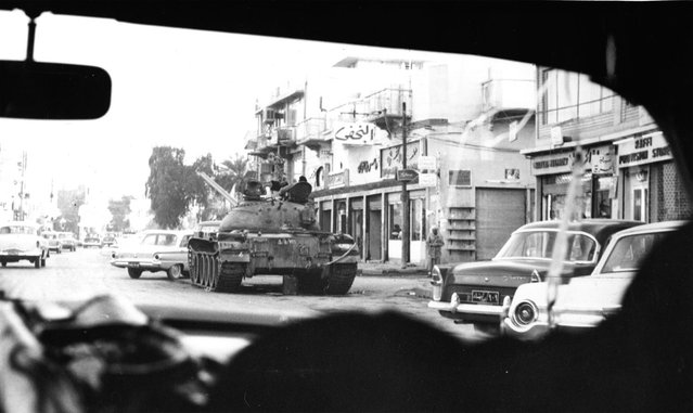 A motorist's view of a street in Baghdad, Iraq, on February 12, 1963, where tanks stand by to prevent further outbreaks of fighting which followed a military coup and overthrow of Premier Abdel Karim Kassem's five-year-old regime by elements of the Ba'ath Party. (Photo by Jim Pringle/AP Photo)