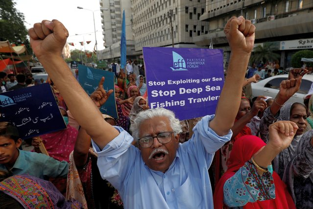 Chairman of the Pakistan Fisherfolk Forum (PFF) Mohammad Ali Shah along with supporters chant slogans against the government's decision to provide licenses to deep sea fishing trawlers, which according to them threatens the livelihoods of small fishermen, during a demonstration in Karachi, Pakistan on September 2, 2020. (Photo by Akhtar Soomro/Reuters)