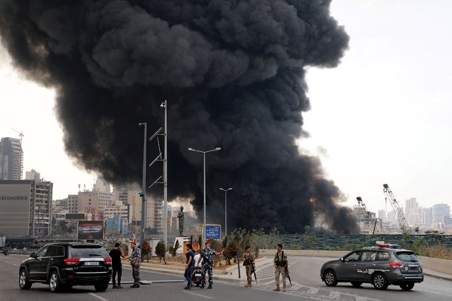 Members of the Lebanese army and police are seen near the site of a fire that broke out at Beirut's port area, Lebanon on September 10, 2020. (Photo by Mohamed Azakir/Reuters)