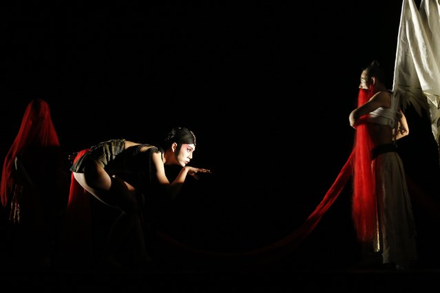 Dancers of the China Beijing Modern Dance Company perform in Midnight Rain at the University of Malta's theatre in Msida, outside Valletta, November 22, 2014. (Photo by Darrin Zammit Lupi/Reuters)