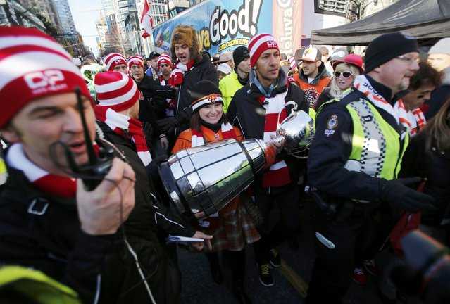 The Grey Cup arrives ahead of  the CFL's 102nd Grey Cup football championship between the Calgary Stampeders and the Hamilton Tiger Cats in Vancouver, British Columbia, November 30, 2014. (Photo by Ben Nelms/Reuters)
