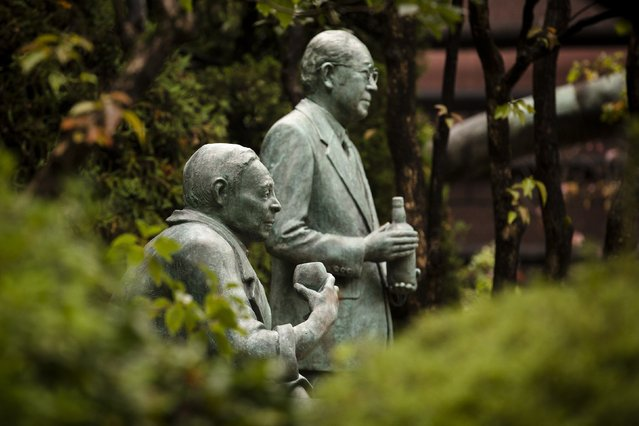 A monument to distillery founder Shinjiro Torii and his son, Keizo Saji, its second generation master blender, stands in the compound of Suntory Holdings' Yamazaki Distillery in Shimamoto town, Osaka prefecture, near Kyoto, December 1, 2014. (Photo by Thomas Peter/Reuters)