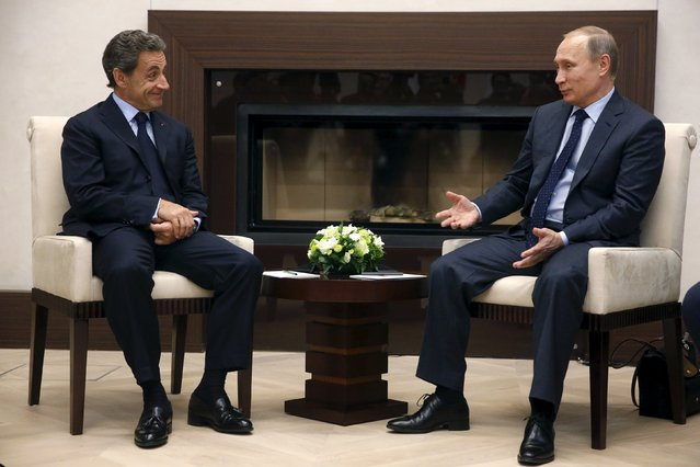 Russian President Vladimir Putin (R) meets with Nicolas Sarkozy, former French president and head of the conservative Les Republicains political party, at the Novo-Ogaryovo state residence outside Moscow, Russia, October 29, 2015. (Photo by Sergei Chirikov/Reuters)