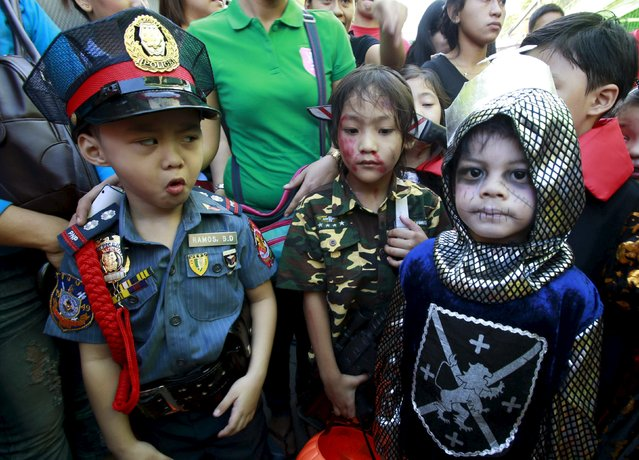 Students of Brainshire School dawn scary and colorful costumes as they participate in a halloween parade in Paranaque city, metro Manila October 30, 2015. (Photo by Romeo Ranoco/Reuters)
