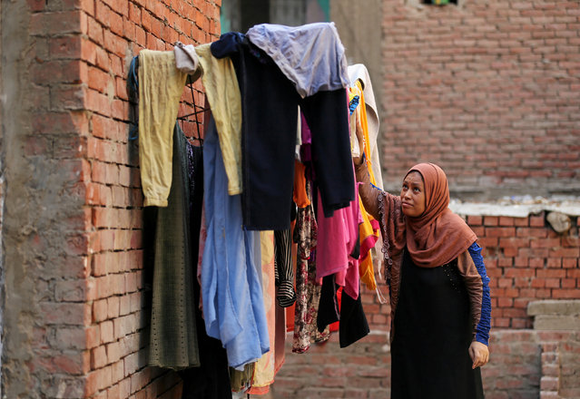 A woman washes clothes in the village of Ezbet Khairallah in Cairo, Egypt October 4, 2016. (Photo by Mohamed Abd El Ghany/Reuters)