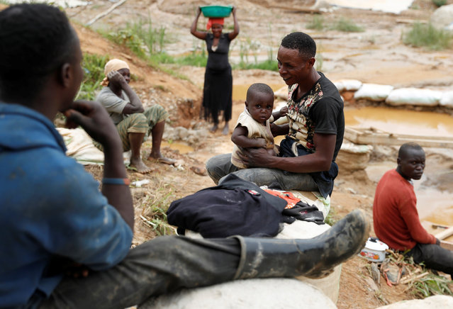 A man plays with his son at Makala gold mine camp near the town of Mongbwalu in Ituri province, eastern Democratic Republic of Congo on April 7, 2018. (Photo by Goran Tomasevic/Reuters)