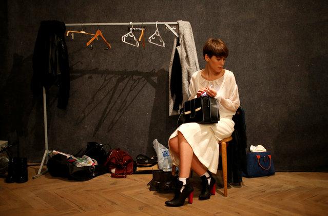 A model waits backstage at the Tbilisi Fashion Week in Tbilisi, Georgia, October 21, 2016. (Photo by David Mdzinarishvili/Reuters)