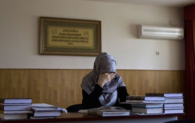 A student attends a lesson in Sharia law at the Russian Islamic University in the Chechen capital Grozny April 23, 2013. (Photo by Maxim Shemetov/Reuters)