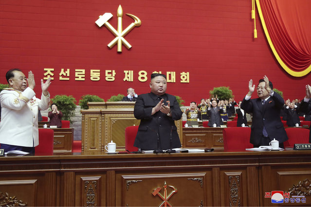 "In this photo provided by the North Korean government, North Korean leader Kim Jong Un, center, claps his hands at the ruling party congress in Pyongyang, North Korean, Sunday, January 10, 2021. Kim was given a new title, ""general secretary"" of the ruling Workers' Party, formerly held by his late father and grandfather, state media reported Monday, Jan. 11, in what appears to a symbolic move aimed at bolstering his authority amid growing economic challenges. Independent journalists were not given access to cover the event depicted in this image distributed by the North Korean government. The content of this image is as provided and cannot be independently verified. Korean language watermark on image as provided by source reads: ""KCNA"" which is the abbreviation for Korean Central News Agency. (Photo by Korean Central News Agency/Korea News Service via AP Photo)"