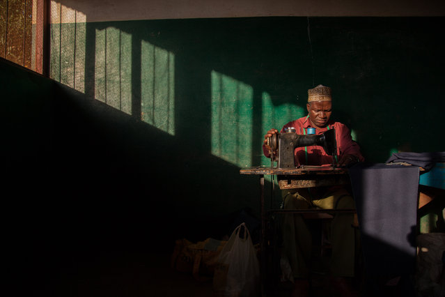"""""""Racing the Sun"""". A tailor for a secondary school races against the sun to sew the last school uniform of the day.  Location: Balama, Cabo Delgado, Mozambique. (Photo and caption by Rafael Hernandez/National Geographic Traveler Photo Contest)"""
