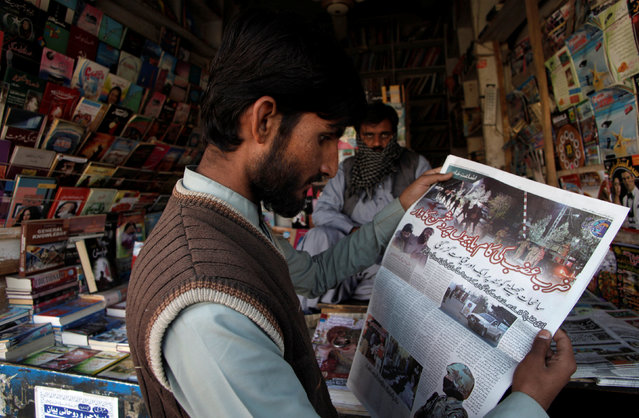 A man reads a newspaper's coverage of the attack on the Police Training College, at a newsstand in Quetta, Pakistan, October 26, 2016. (Photo by Naseer Ahmed/Reuters)