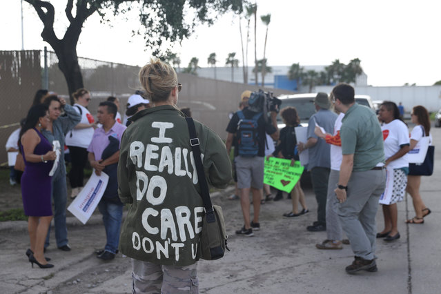 A woman protesting the detainment of undocumented immigrant children wears a jacket referencing Melania Trump during a demonstration outside a U.S. Border Patrol processing center in McAllen, Texas, June 25, 2018. (Photo by Loren Elliott/Reuters)