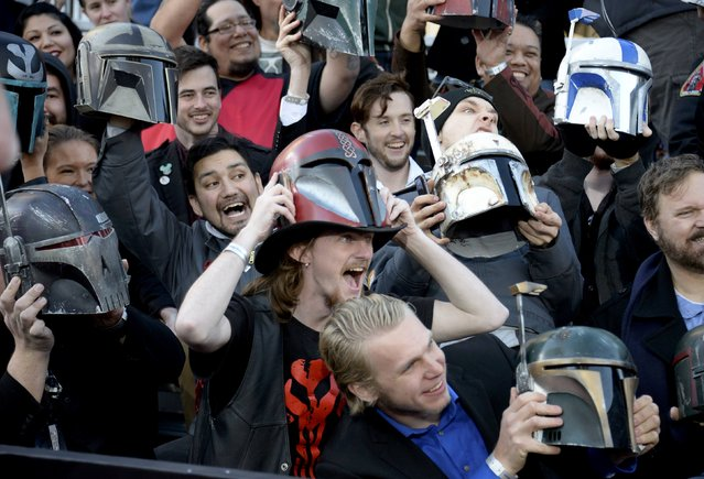 "Fans hold up helmets at the premiere of ""Star Wars: The Force Awakens"" in Hollywood, California, December 14, 2015. (Photo by Kevork Djansezian/Reuters)"