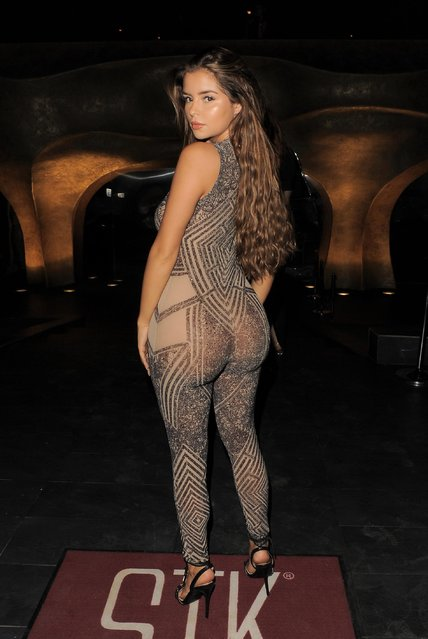 The social media star Demi Rose, 23, struck a series of poses at the entrance to the STK Ibiza restaurant, showing off her curves from all angles in Ibiza, Spain on Tuesday, August 7, 2018. (Photo by KP Pictures)