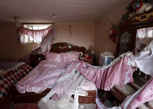 """A damaged bed is seen inside a house after a suicide attack on French restaurant  """"Le Jardin"""" in Kabul, Afghanistan January 2, 2016. (Photo by Mohammad Ismail/Reuters)"""