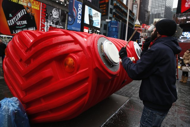 "Drummers perform on ""HeartBeat"" by Stereotank, a Brooklyn-based design studio, which is the 2015 winning Times Square Valentine Heart produced by the Times Square Alliance, in New York City February 9, 2015. The interactive sculpture consisting of a massive heart that visitors are encouraged to move around and play various percussion instruments on, is installed at Times Square and open to the public until March 8. (Photo by Mike Segar/Reuters)"