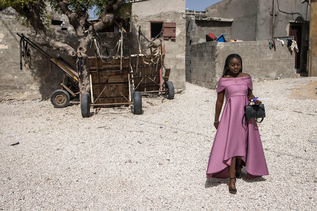 A Catholic worshipper makes her way to Easter Mass in Fadiouth on April 4, 2021. (Photo by John Wessels/AFP Photo)