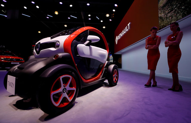 Models stand next to a Renault Twizy electric car at the 2018 Moscow International Motor Show at the Crocus Expo exhibition center in Moscow Region, Russia on August 29, 2018. (Photo by Maxim Shemetov/Reuters)