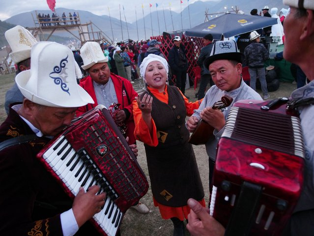"Nazira Ivanova rehearses with her bandmates before taking the stage at an event for traditional music. The song, which stopped several passersby in their tracks, was ""about love"", she told RFE/RL. (Photo by Amos Chapple/Radio Free Europe/Radio Liberty)"