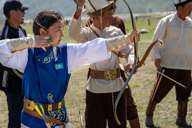 Aliya Kamalova from Kazakhstan practises with men before the finals of horse-mounted archery. At 21, she's been doing the sport for two years; the first year was just learning how to ride a horse. In the beginning people told her it wasn't a sport for women, but she pursued it because she feels it is a part of the Kazakh blood. (Photo by Eleanor Moseman/The Guardian)