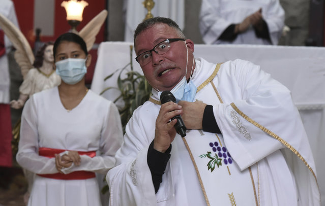"Sergio Valverde Espinoza, a Catholic priest of the Cristo Rey church who modified a popular song called ""Sopa de Caracol"", or Snail Soup in English, gestures during a Mass in San Jose, Costa Rica, Sunday, May 2, 2021. Valverde changed the song's lyrics to a message calling for the use of face masks and care during the pandemic. (Photo by Carlos Gonzalez/AP Photo)"