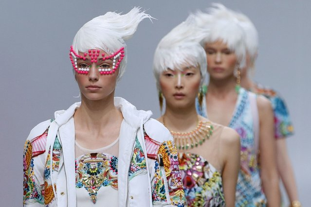 Models present creations by Manish Arora during the 2014 Spring/Summer ready-to-wear collection fashion show in Paris, on September 27, 2013. (Photo by Patrick Kovarik/AFP Photo)