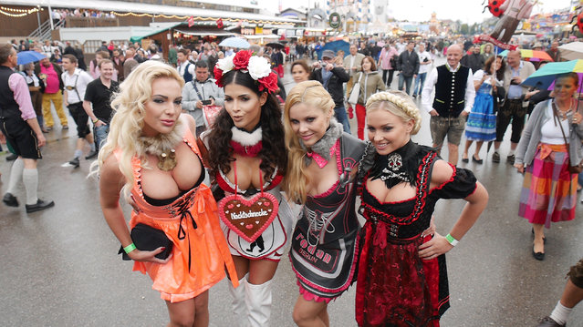 Micaela Schaefer (2nd from Left) and Yvonne Woelke (2nd from right) sighted during Oktoberfest at Theresienwiese on September 21, 2014 in Munich, Germany. (Photo by Chad Buchanan/Getty Images)