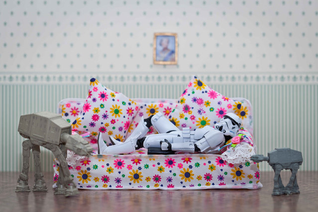 A storm trooper lies on the sofa, taken in Glasgow, Scotland, December 2016. (Photo by David Gilliver/Barcroft Images)