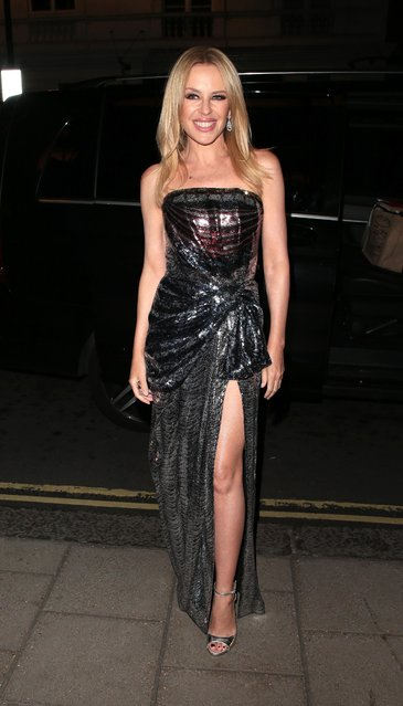 """Kylie Minogue is seen leaving """"We Are Most Amused and Amazed Comedy Gala"""" at The London Palladium on October 22, 2018 in London, England. (Photo by Ricky Vigil/GC Images)"""