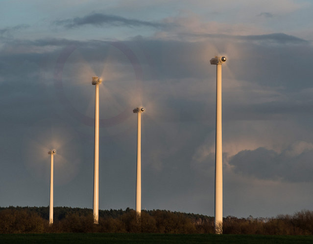 A photo made available 31 March 2015 of the rotors of wind turbines spinning fast during strong wind on a field in Petersdorf, Germany, 30 March 2015. (Photo by Patrick Pleul/EPA)