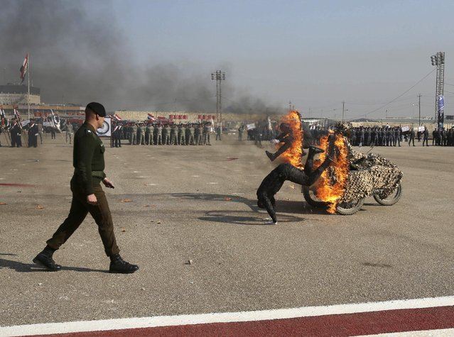 Iraqi Federal Police demonstrate their skills during a ceremony marking Police Day at the police academy in Baghdad, Iraq, Saturday, January 7, 2017. (Photo by Karim Kadim/AP Photo)