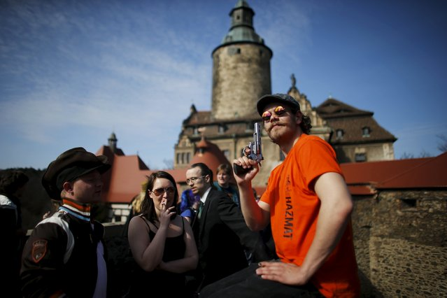 A man pose as he arrived for the role play event at Czocha Castle in Sucha, west southern Poland April 9, 2015. (Photo by Kacper Pempel/Reuters)