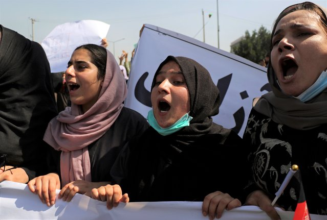 Afghan women shout slogans during an anti-Pakistan demonstration, near the Pakistan embassy in Kabul, Afghanistan, Tuesday, September 7, 2021. (Photo by Wali Sabawoon/AP Photo)