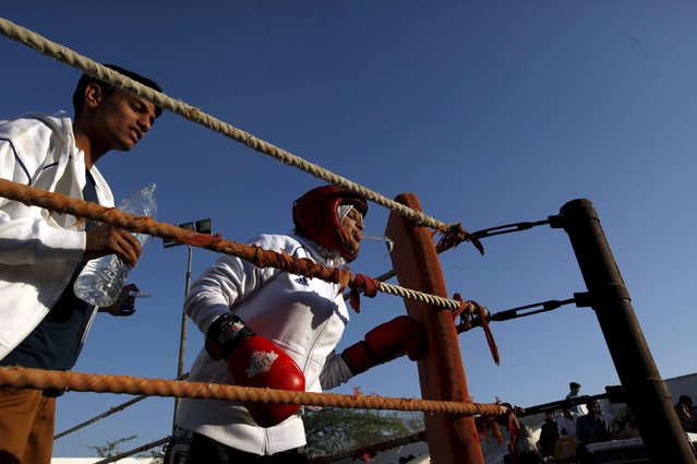 Urooj, 15, spits water between rounds in her bout during the Sindh Junior Sports Association Boxing Tournament in Karachi, Pakistan February 21, 2016. (Photo by Akhtar Soomro/Reuters)