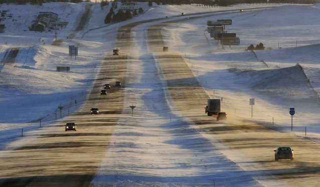 Tribune Strong winds and ground blizzard conditions greeted motorists on Interstate 94 around sunrise, Thursday, January 12, 2017, west of Mandan, N.D. An Arctic cold front entered the state with winds gusting to 55 mph reducing visibility along the interstate and causing hazardous travel conditions and dangerous wind chills. (Photo by Tom Stromme/The Bismarck Tribune via AP Photo)