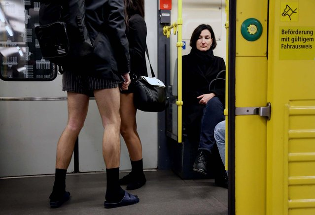 A subway passenger looks at participants of the No Pants Subway Ride in Berlin. (Photo by Adam Berry/Getty Images)