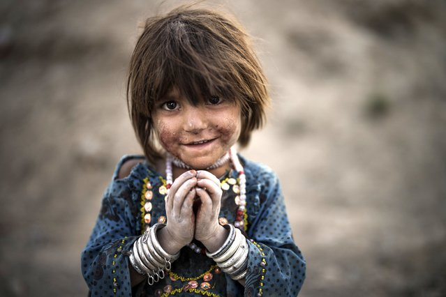 Laila poses for a photo as she plays at a poor neighborhood where hundreds of internally displaced people from the eastern part of the country have been living for years, in Kabul, Afghanistan, Monday, September 27, 2021. (Photo by Felipe Dana/AP Photo)
