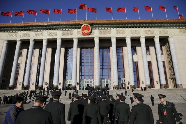Military delegates arrive at the Great Hall of the People for the third plenary session of the National People's Congress (NPC), in Beijing, China, March 13, 2016. (Photo by Damir Sagolj/Reuters)