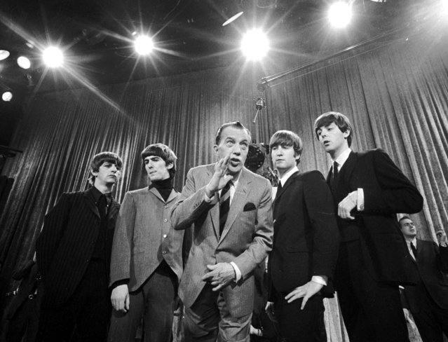 "Ed Sullivan, center, stands with The Beatles during a rehearsal for the British group's first American appearance, on the ""Ed Sullivan Show"", in New York on February 9, 1964. From left: Ringo Starr, George Harrison, Sullivan, John Lennon and Paul McCartney. The rock 'n' roll band known as ""The Fab Four"" was seen by 70 million viewers. ""Beatlemania"" swept the charts with twenty No. 1 hits and more than 100 million records sold.  The Beatles broke up in 1970. (Photo by AP Photo)"
