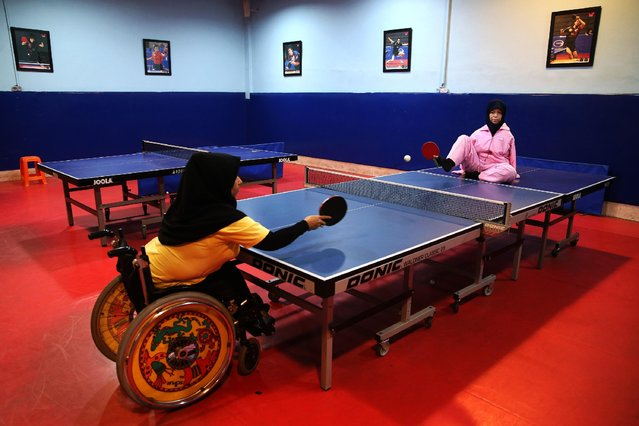 In this picture taken on Sunday, January 18, 2015, Zohreh Etezadossaltaneh, right, who was born without arms, plays ping pong using her toes to hold the paddle in a sport club in Tehran, Iran. Etezadossaltaneh's skill at ping pong has led to her being featured in public exhibition matches. But she insists that she wants to be more than just a symbolic figure of inspiration. (Photo by Ebrahim Noroozi/AP Photo)