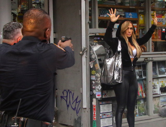 "Jennifer Lopez pictured surrounded cops pointing their guns at her during a scene at the ""Hustlers"" movie set in Downtown, Manhattan on April 1, 2019. (Photo by Jose Perez/Splash News and Pictures)"