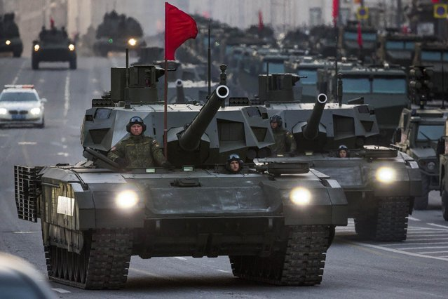 New Russian military vehicles including the new Russian T-14 Armata tank, foreground, make their way to Red Square during a rehearsal for the Victory Day military parade which will take place at Moscow's Red Square on May 9 to celebrate 70 years after the victory in WWII, in Moscow, Russia, Monday, May 4, 2015. (Photo by Alexander Zemlianichenko/AP Photo)