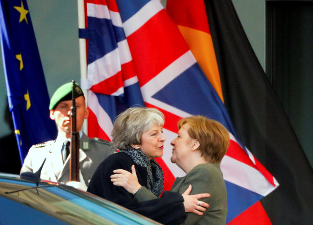 German Chancellor Angela Merkel kisses British Prime Minister Theresa May as she leaves after they met to discuss Brexit, at the chancellery in Berlin, Germany, April 9, 2019. (Photo by Hannibal Hanschke/Reuters)